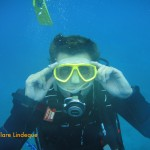 Darryl the divemaster dons a mask he found on the reef