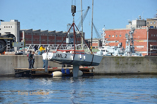 Yacht being removed from the water in preparation for the Lipton Cup