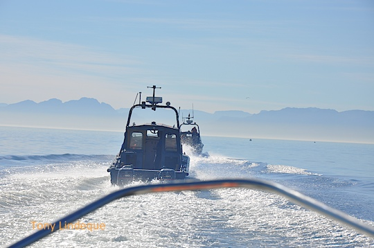 Leaving Simon's Town harbour with a navy patrol boat escort