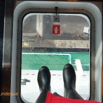 Standing on a piece of the bridge that overhangs the edge of the ship