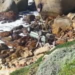 Lowering the Pajero onto the rocks