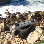 Family sedan resting on the rocks