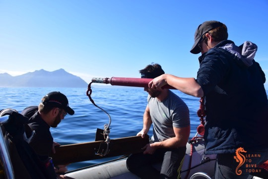 Deploying an acoustic receiver outside Hout Bay