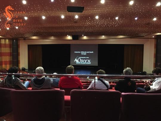 Attending a talk in the ship's theatre