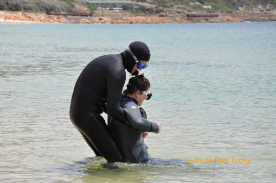 Corne practises rescue skills on Kate
