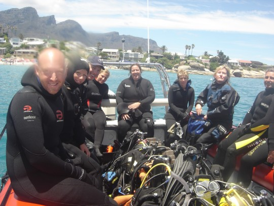 Happy divers on the boat