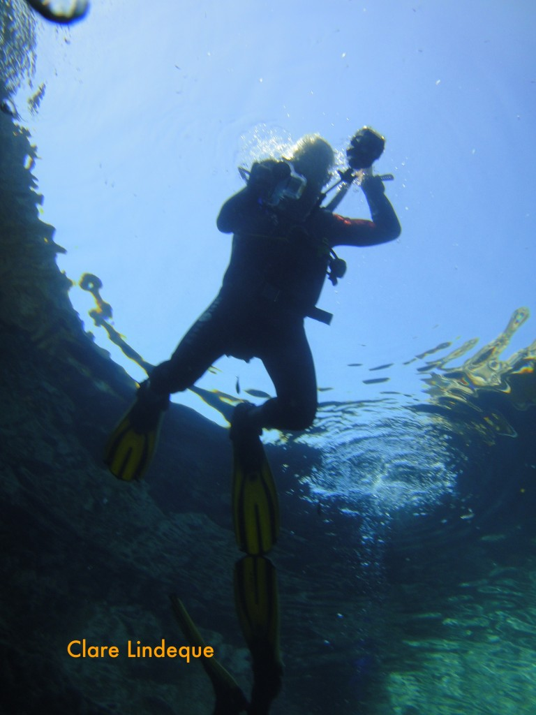 My handsome husband descends into the Blue Hole