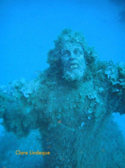Christ's face is upturned towards the surface (or heaven, if you prefer)