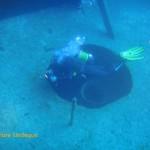 Tony inside a large hole on deck