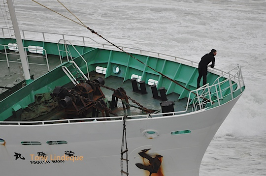 Salvage personnel in the bow of the ship