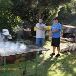 Adriaan (right) supervises the fires for the bring and braai