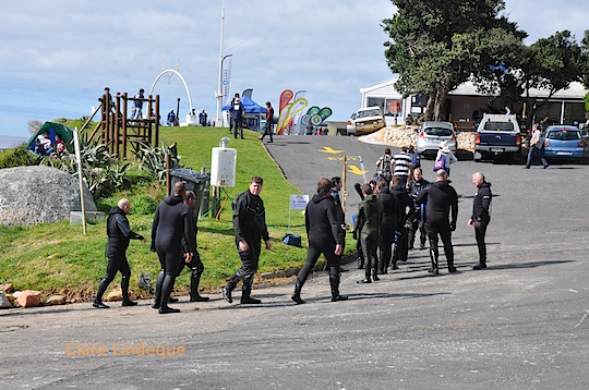 Divers walk up the slipway to the hot shower on the grass