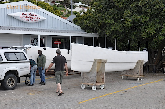 Two pieces of a catamaran waiting for assembly at FBYC