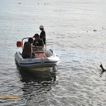 Discussions between boat crew and diver