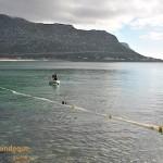 The boat alongside the net