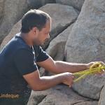 Boeta attaches the net to the rocks