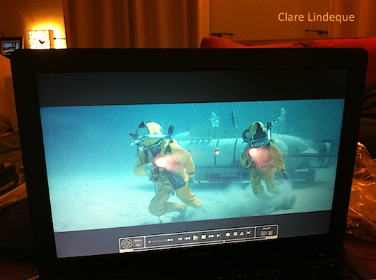 The divers race across the ocean floor from their submersible