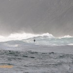 The wave breaks in front of Duiker Island, swamping it