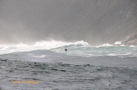 The wave breaks in front of Duiker Island, swamping it