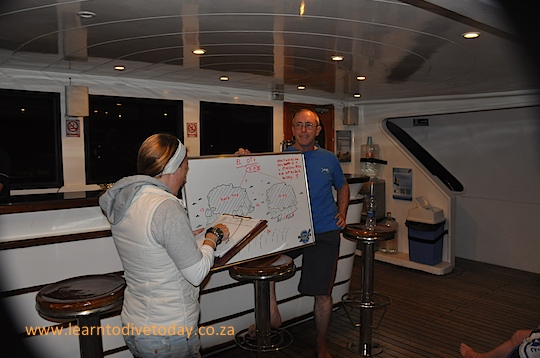 Christo and Becky after a dive briefing
