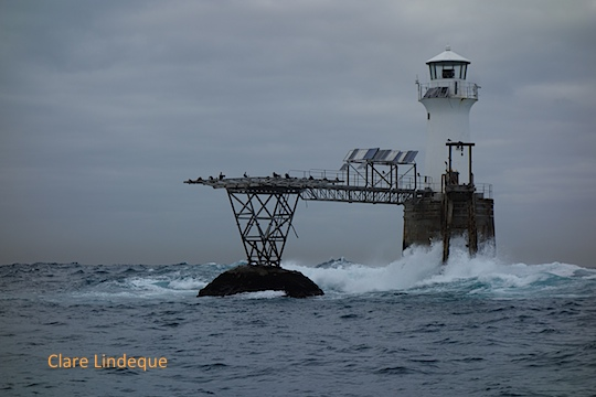 Big swell breaking at Roman Rock lighthouse