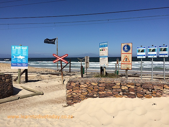 The signs and Shark Spotters flag at Glencairn