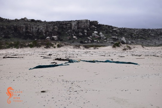 Fishing net on the beach between the two wrecks