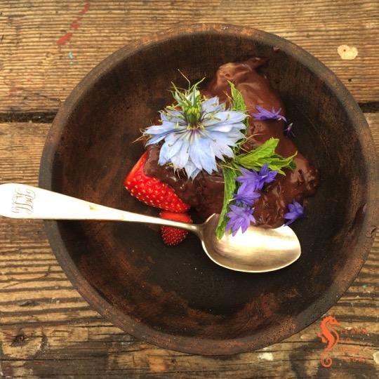 Chocolate nori ice cream with edible flowers