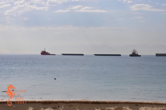 Two of the salvaged barges leaving Simons Town harbour in April 2012