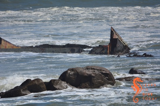 Sharp wreckage sticking out of the sea